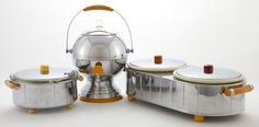 A three-piece Manning-Bowman chromed metal and bakelite kitchen appliance set, circa 1930.