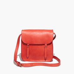 Madewell - The Watertower Messenger Bag Comes in brown as well, but thought this color would pair well with your earth tones. Offers a nice subtle pop of color.