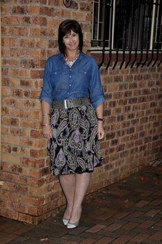 Denim shirt, paisley skirt and grey pumps