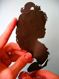 Someone from my ancestors used to do this...Scherenschnitte, the ancient art of papercutting, is German for 'scissors snips.So,there you go.