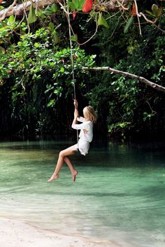 Swing, swing- summer fun! And that water- crystal clear- could dive right in
