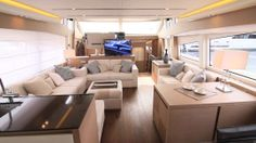 Prestige 750: The salon can accommodate many guests in comfort. A flatscreen TV is on an electric lift. All windows provide clear sightlines to the horizon from the seated positions.