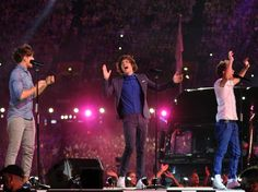 Louis Tomlinson Harry Styles and Niall Horan performing at the Closing Ceremony of the Olympics