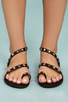 Be a star-spangled cutie in the Alexi Black Studded Star Sandals! Vegan leather, adorned in brushed gold star studs, forms a toe loop upper and a unique asymmetrical ankle strap.