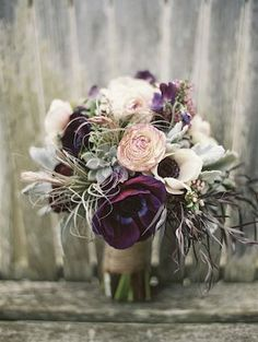 Purple anemone and succulent bridal bouquet