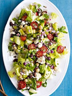 This Greek chopped salad is chock-full of big cherry tomatoes, hunks of feta, olives, and chickpeas.