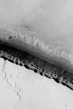 Cerberus Fossae Trough August 27, 2013 Mars Global Surveyor (MGS) Mars Orbiter Camera (MOC) image provides a look down into one of the long, dark, Cerberus Fossae troughs near 10.2°N, 202.6°W. Faulting and extension of the upper martian crust in this region has caused numerous troughs such as this to form.