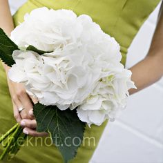 Simple white hydrangea bouquets were stunning against the backdrop of the bridesmaids' cypress-colored dresses.