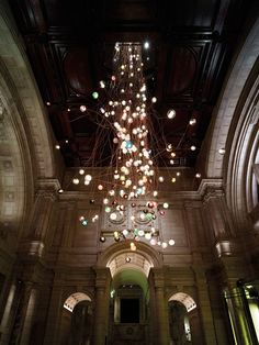bocci bocci has suspended 280 of its 28 series of hand blown glass lights on spindly copper wires to create a chandelier designed by omer arbel architect omer arbel office click