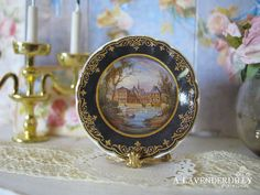 ♥♥ This decorated ceramic plate is a reproduction of a vintage design. It is 25mm (1 inch) across. The photo is a sample of the item you will receive. It is in 1/12 scale made for miniature/dollhouse. ♥♥ *Price is for one plate only*    Unless otherwise stated – I can always make more quantities of any plate design. If there are not enough listed as available for your needs, please convo me before purchasing and I will increase the number available for you.    Please read my policy section…