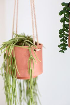Make these DIY Terracotta Clay Hanging Planters with just a few inexpensive materials at home. No pottery skills needed! Head to Fall For DIY now! Diy Planters, Hanging Planters, Make Clay Beads, Clay Handprint, Plant Shelves, Vase, Diy Clay, Plant Holders, Terracotta