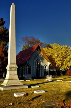 THE LORD'S CHAPEL AND THE CRUMP MONUMENT by Midge Gurley on Capture Memphis // The Fall colors created a golden glow around the The Lord's Chapel and the E.H. Crump monument at Elmwood Cemetery.