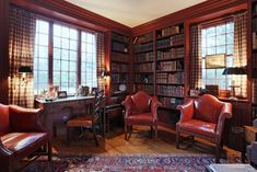 Three large chimneys define the home's silhouette, serving five wood burning fireplaces that further enhance the New England ambience. This small cozy room is most often used in the winter. It is all wood, painted Williamsburg Red.