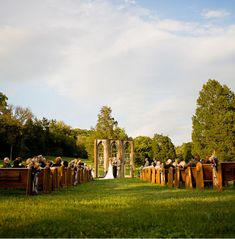 So beautiful. They brought old chapel pews and arches outdoors. (Another pinner said ~ I recommend looking at the rest of this wedding's pic because it's probably the cutest thing ever)!