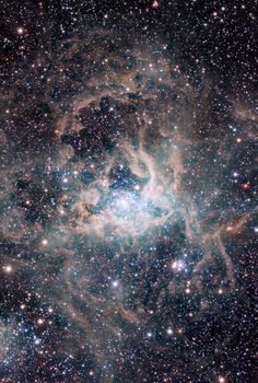 "Magellanic Cloud Survey view of the Tarantula Nebula | The leader of the survey team, Maria-Rosa Cioni (University of Hertfordshire, UK) explains: ""This view is of one of the most important regions of star formation in the local Universe, the spectacular 30 Doradus star-forming region, also called the Tarantula Nebula. At its core is a large cluster of stars called RMC 136, in which some of the most massive stars known are located."""