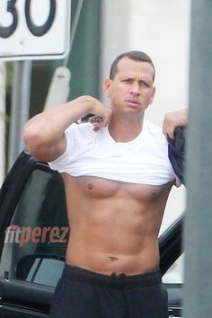 NY Yankees - Alex Rodriguez.  It would be fun to have the team line up and rate their abs! hahaha