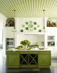 Cute white and green kitchen with wallpapered ceiling! Hate wallpaper? Paint the pattern on with a stencil!