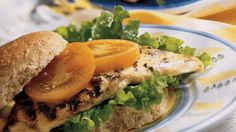 This is no plain old grilled chicken breast sandwich. Brushing on a seasoned honey mustard baste turns the ordinary into something special.