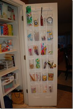 I organized with a shoe holder!  Check it out:  www.fortheloveofpainting.com Classroom Organization, Jewelry Organization, Comfort Keepers, Over The Door Organizer, Utility Closet, Shoe Holders, Spray Paint Cans, Garage, Hall Closet