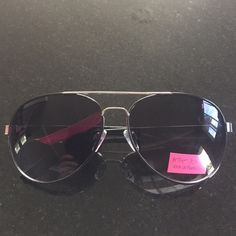 Betsey Johnson sunglasses Betsey Johnson silver aviator sunglasses with 100% UV smokey rose protection lenses.  Black sides.  New with tag attached. Betsey Johnson Accessories Sunglasses