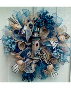 This is my first entry into this contest.  I have designed a Nautical Lighthouse wreath using jute burlap, deco mesh and ribbons.  I embellished it with a rustic lighthouse and real shells from the Florida Gulf Coast.  I hope you like it.