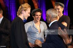 Tristan Evans, Bradley Simpson and James McVey of The Vamps talk with Mayor of London Sadiq Khan during the London Autumn Season launch at the Natural History Museum on August 31, 2017 in London, England.