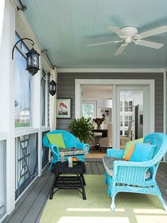 Screened in porch, craftsman, gray plank deck flooring, white trim, painted beadboard ceiling, ceiling fan, moroccan lantern, painted wicker furniture, black, aqua, turquoise, green