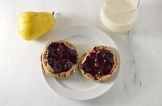 Ezekiel English muffin toasted with homemade almond butter and homemade jam!