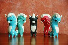 They are soooooo cute!!!  Resin Toys by Teodoru Badiu, via Behance