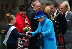 Queen Elizabeth II Photos - Queen Elizabeth II receives posey of flowers at Waverley Station before boarding the steam locomotive 'Union of South Africa' on September 9, 2015 in Edinburgh, Scotland. Today, Her Majesty Queen Elizabeth II becomes the longest reigning monarch in British history overtaking her great-great grandmother Queen Victoria's record by one day. The Queen has reigned for a total of 63 years and 217 days. Accompanied by her husband The Duke of Edinburgh, she has today…
