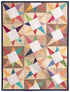 Cosmos Baby Quilt, pattern from Vintage Q I like the colours and the offset of the middle column