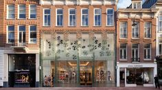 MVRDV has used a pioneering glass technology to replace the brick facade of a former townhouse in Amsterdam with a transparent replica