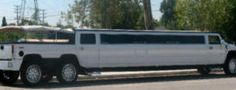 Hummer limo Orange County: This is a canopy top white Hummer Limo cruising PCH!