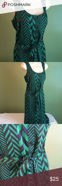Michael Kors chevron dress Beautiful, soft, silky Michael Kors dress.  Green and navy blue chevron pattern.  Buttons down all the way from top to bottom.  Has a tie waist that is tunneled all the way through the fabric.  Great dress.  States it's a size medium but it will also probably fit a large. Michael Kors Dresses