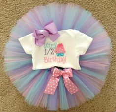 It's my half birthday cupcake tutu outfit. light pink, aqua, and lavender tutu  6 month pictures, half birthday tutu
