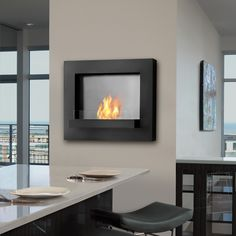 Edgerton wall fireplace, add a Real Flame ventless fireplace to any space with this stunning wall-hung fireplace. Powder coated and stainless steel construction adds a lasting statement of contemporary elegance. This fireplace features easily adjustable pantent pending flame technology and is refillable with Real Flame ventless fireplace fuel for ease of use. Emitting up to 9000 btus of heat per hour, lasting up to three hours of cozy warmth.