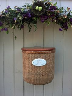 Nantucket Basket Mailbox for door. This unique mailbox is made of cherry wood base, rim, lid and brace, and finished with marine varnish. it is made with cherry staves and woven with cane, bone plugs and brass escutcheon pins. Nantucket Cottage, Nantucket Baskets, Nantucket Island, Nantucket Style Homes, Home Decor Baskets, Basket Decoration, Unique Mailboxes, Beach Cottage Decor, Beach Cottages