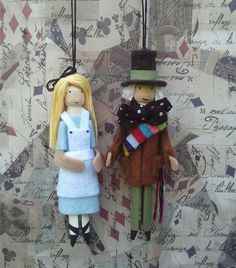 Alice and the Mad Hatter... Alice is wearing a blue dress with a white pinafore.Her hair is decorated with a black bow. She measures 4 1/2