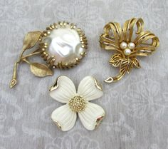 Vintage signed brooches lot - all in gold tone with pearl/white accent. These brooches are all very dimensional and stand out from pins. 1. Sarah