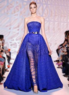 Strapless bustier ball gown with beaded sapphire wave body and train en silhouette