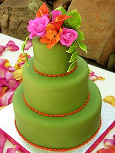 One of the hottest (and brightest) new color combos, this hot pink, orange and lime green confection (with mango passionfruit cake inside) completely matched the centerpieces and linens at this outdoor wedding by the creek at LAuberge de Sedona.