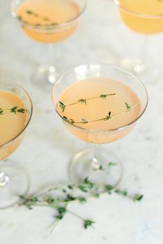Brûléed Grapefruit Gin Fizz - Bruleed Grapefruit Juice (Recipe), Gin, Club Soda, Thyme Sprig, Spritz of Lime.