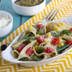 Pappardelle with fresh summer veggies tossed with a pesto ricotta sauce