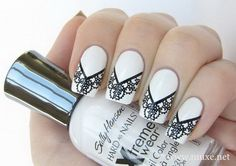 elegant black and white lace nails.