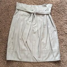BCBGMAXAZRIA skirt - size 4 Pockets on both sides. Very comfortable high wasted skirt.  Worn only couple of times.  Zipper and hook closure on the left side.  Inside fully lined.  Belt in perfect condition.  Comes from a pet/smoke free home. BCBGMaxAzria Skirts
