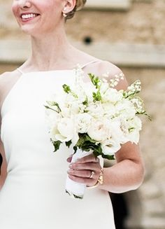 White bouquet with roses, lisianthus and lily of the valley #weddingbouquet #bridalbouquet #luxurywedding #castlewedding #luxuryweddingplanner | Fête in France www.feteinfrance.com