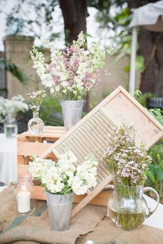 I like the decor – floral contiansers, crate and burlap. Not to mention I'm a major fan of mason jars.