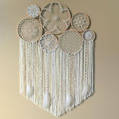 This gorgeous dreamcatcher/ crochet wall hanging would be the perfect backdrop for your bohemian wedding, or hanging above your bed, sofa, or mantel, or in your boho nursery! Dream catchers are said to protect the sleeping individual from negative dreams, while letting positive dreams through. • Please Note: This is a made to order listing. Photos are an example. Crocheted patterns will vary. Each wall hanging is truly one-of-a-kind! You can have this wall hanging made in a combination...