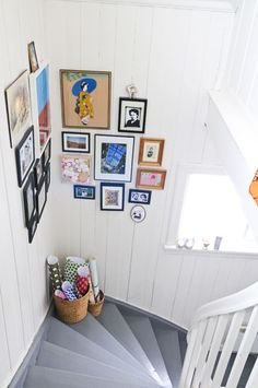 Love the picture frame arrangement - for black frame access in stairwell? With the new prints, collage frames & single frames? @Jessica Szubart... is this TOO much cluster frames?
