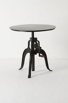 Anthropologie adjustable side table (love it - very steam punk)